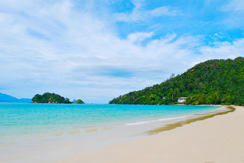 View from a beach in a tropical island, Langkawi in Malaysia : blue sky, blue water and sand.